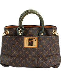 Sac à main en python Louis Vuitton en coloris Brown