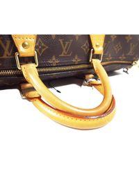 Borsa a mano in tela marrone Speedy di Louis Vuitton in Brown