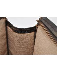 Bolsos de viaje en lona marrón Louis Vuitton de color Brown