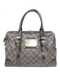 Borsa a mano in scamosciato marrone di Louis Vuitton in Brown