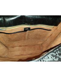 Bolsa de mano en lona crudo Céline de color Black