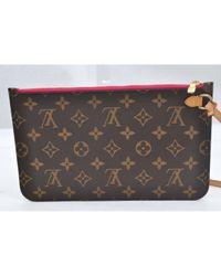 Pochette in tela marrone di Louis Vuitton in Brown