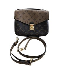 Louis Vuitton - Brown Pre-owned Leather Bag - Lyst