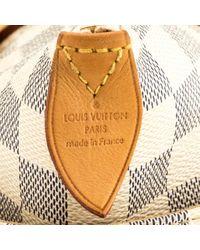 Bolsa de mano en lona Totally Louis Vuitton de color Multicolor