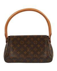 Bolsa de mano en lona marrón Louis Vuitton de color Brown