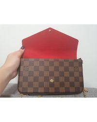 Bolsa clutch en lona marrón Félicie Louis Vuitton de color Brown