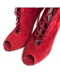 Boots \N en Suede Rouge Gianvito Rossi en coloris Red