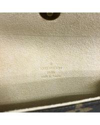 Louis Vuitton Brown Florentine Leinen Clutches
