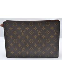 Bolsa de mano en lona marrón Louis Vuitton de color Brown