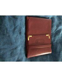 Porte-chéquier cuir rouge Cartier en coloris Red