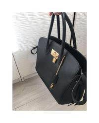 Sac à main en cuir cuir noir Louis Vuitton en coloris Black