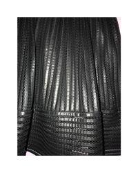 Jupe mi-longue polyester noir Maje en coloris Black