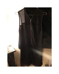 Robe mi-longue polyester noir Sandro en coloris Black