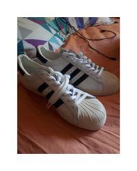 Baskets cuir blanc Adidas pour homme en coloris White