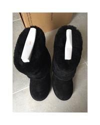 Bottes de neige cuir noir Ugg en coloris Black