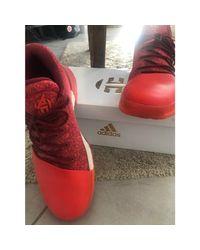Baskets tissu orange Adidas