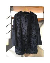 Manteau en fourrure fourrure noir Maje en coloris Black