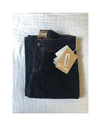 Jeans très evasé, patte d'éléphant denim, jean bleu John Galliano en coloris Blue