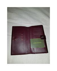 Portefeuille cuir verni rose Longchamp en coloris Pink