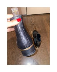 Santiags, bottines, low boots cowboy cuir noir Louis Vuitton en coloris Black