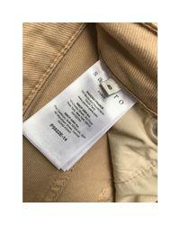 Jeans évasé, boot-cut coton beige Sandro en coloris Natural