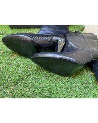 Bottes à talons cuir noir The Kooples en coloris Black