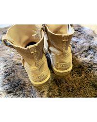 Santiags, bottines, low boots cowboy daim doré Ugg en coloris Metallic