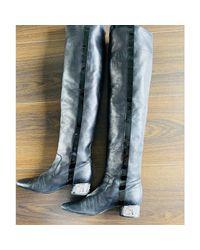 Bottes cuissards cuir noir Chanel en coloris Black