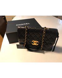Sac en bandoulière en cuir cuir noir Chanel en coloris Black