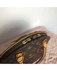 Sac à main en tissu cuir marron Louis Vuitton en coloris Brown