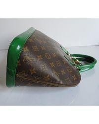 Sac à main en cuir cuir Alma vert Louis Vuitton en coloris Green