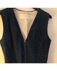 Combinaison denim, jean bleu Maje en coloris Blue