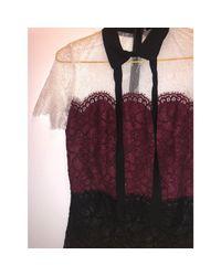Robe courte dentelle noir Sandro en coloris Black