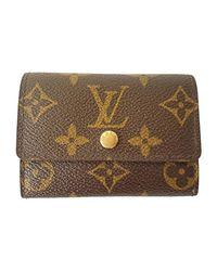 Portefeuille toile enduite marron Louis Vuitton en coloris Brown