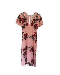 Robe mi-longue soie rose Sandro en coloris Pink