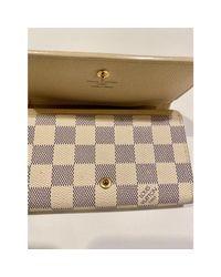 Portefeuille cuir beige Louis Vuitton en coloris Natural
