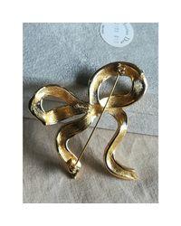 Broche métal doré Dior en coloris Metallic