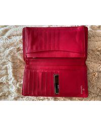 Pochette cuir rouge Chanel en coloris Red
