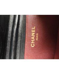 Sac en bandoulière en cuir cuir Wallet-On-Chain noir Chanel en coloris Black