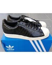 Baskets cuir noir Adidas en coloris Black