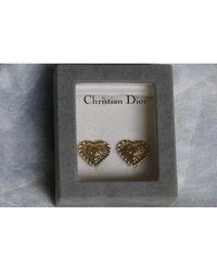 Boucles d'oreilles métal doré Dior en coloris Metallic