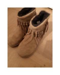 Bottines & low boots plates cuir beige Ugg en coloris Natural