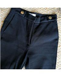 Pantalon évasé autre bleu Sandro en coloris Blue