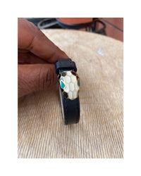 Bracelet cuir noir BVLGARI en coloris Black