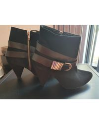 Bottines & low boots à talons nubuck noir Sandro en coloris Black