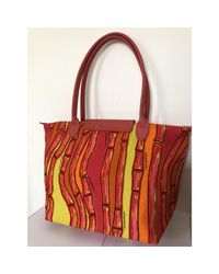 Sac à main en tissu tissu Pliage multicolore Longchamp en coloris Red