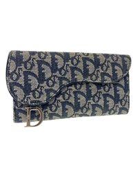 Portefeuille toile Saddle bleu Dior en coloris Blue