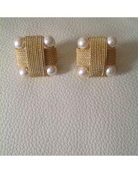 Boucles d'oreille métal doré Valentino Garavani en coloris Metallic