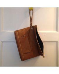 Sac pochette en cuir cuir beige Longchamp en coloris Natural