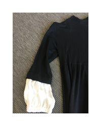 Robe courte laine noir Sandro en coloris Black